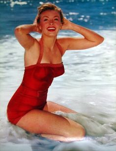1956  Love the suit, and clean lipstick lines