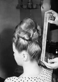 "Measuring a towering 11"" coiffure (from the nape of the neck to the tip of the crown), 1945. #vintage #1940s #hair"