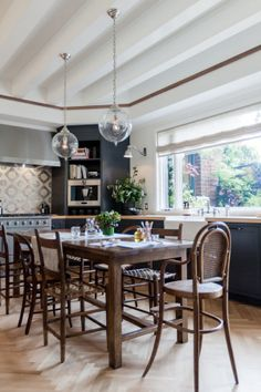 A long farm table with informal seating sits in the middle of the kitchen, perfect for food prep or homework.