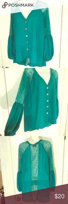 Mint boutique blouse Pretty mint color lace cutout top with belled sleeves. In EUC size Medium, but can also fit a small if you like the oversized flowy look. dejavu Tops Button Down Shirts