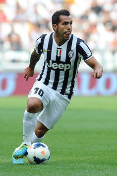 Carlos Tevez of #Juventus drives forward!