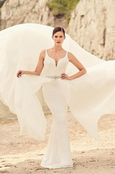 View Detachable Organza Skirt Wedding Dress - Style #2120 from Mikaella Bridal. Lace gown with multiple crossover straps at back. Organza overskirt.