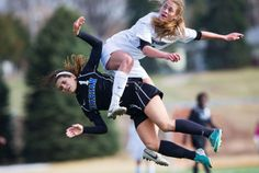Millard North 2, Omaha Marian 1: Omaha Marian's Margaret Begley gets tangled up with Millard North's Kailey Lane during the first half of the Metro Conference soccer finals on April 15, 2014. By: CHRIS MACHIAN/THE WORLD-HERALD