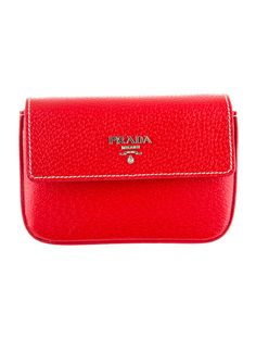 Seeing red with this classic Prada Pouch Bag.