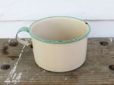 rustic cream & green enamelware mug ~ vintage cream enamelware with green rim and handle ~ farmhouse antique from etsy.com