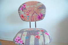 recovered with a vintage blanket, applique and embroidery. fun.
