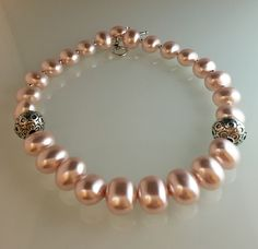 Pink potato pearls, lg embossed pewter with SS overlay, toggle clasp