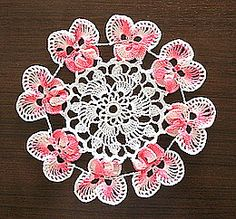 Pansy doily.  Would be pretty appliqued to a jacket.