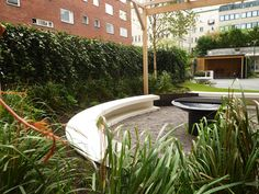 Courtyard in Stockholm, ivy, birches, grill place, pergola, concrete, furniture from Amop. Design and planting by Garden by anna.