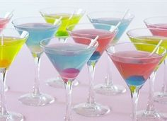 colored martinis with different flavored lollipops... so pretty & I bet they taste so yummy!