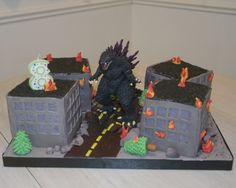 My friend's son wanted a Godzilla Cake and I was not about to scuplt Godzilla out of cake, so he got a Godzilla toy with burning buildings and trees and a torn up road under Godzilla. Godzilla Party, Godzilla Birthday Party, Godzilla Toys, Minion Birthday, Boy Birthday Parties, Baby Birthday, Birthday Ideas, Birthday Cakes, Building Cake
