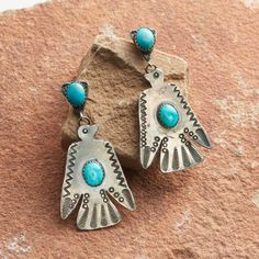 """VINTAGE THUNDERBIRD EARRINGS -- In the Native American tradition, the thunderbird is a powerful symbol of transformation, lending the wearer a sense of strength and confidence. These vintage earrings are entirely handmade in sterling silver, ornamented with blue turquoise. As proof of their lineage, they boast a wonderful, weathered patina. Sterling silver posts. One of a kind, exclusively at Sundance. 2-1/8""""L x 1-1/8""""W."""