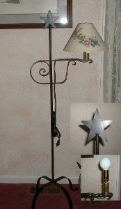 """Wrought Iron Floor Lamp Star Top - Amish Made by Hand Crafted & American Made!. $59.95. Our hand wrought iron pieces are made for us in the Lancaster County PA Amish Community. With classic style and functional design these versatile pieces blend into most decorating schemes. This floor lamp is sometimes called a """"Quilter's Lamp"""" because it adjusts up or down making it nice for reading or sewing or other close work. At its tallest with the bulb in place it is 5 ft tall. This has ..."""