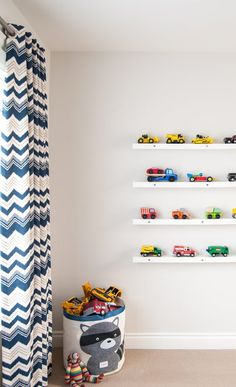 A stylish way to display and store toy cars: use picture ledges.