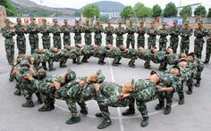 Young soldiers take part in a team-building exercise during training in Tongling, China