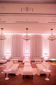 We love the soft pink uplighting and use of lounge furniture. Give people a place to relax at your wedding or reception!