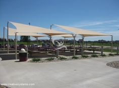 The Kite Sail Shade is a hyperbolic style shade structure. This shade uses four posts, but one post is taller then the others. The fabric is then tensioned to these posts, creating a shade that offers a maximum amount of coverage. Kite Sailing, Shade Structure, Dog Park, Shade Garden, Playground, Bing Images, Shades, Patio, Building