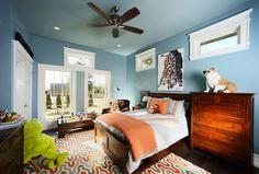 blue bedroom, orange accents, clerestory windows, white trim (Sherwin Williams, Moody Blue)