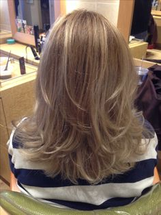 Medium length layered hair cut.