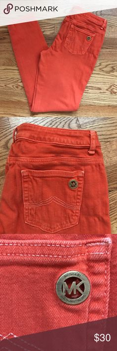 Orange Michael Kors Jeans Orange Michael Kors skinny/straight leg jeans, size 10. Only worn a handful of times, so they are in great condition. No flaws or stains. A fun pair of jeans for any occasion! MICHAEL Michael Kors Jeans Skinny