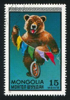 MONGOLIA - CIRCA 1973: stamp printed by Mongolia, shows Bear riding wheel, circa 1973