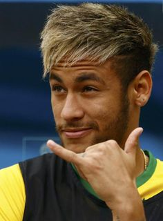 Brazil's Neymar gestures on the bench before the start of their 2014 World Cup third-place playoff against the Netherlands at the Brasilia national stadium in Brasilia July 12, 2014.
