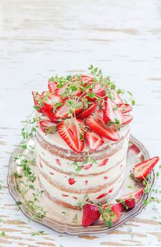 Naked cake design with strawberries and mint sprigs. . Lovely.