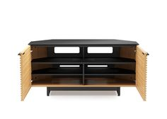The CORRIDOR 8175 corner media cabinet is two compartments wide and has tapered rear panels, allowing it to perfectly fit either into a corner or flat against a wall. The two louvered doors open to reveal a compartment with an adjustable shelf, allowing 8175 to accommodate a soundbar speaker and a range of electronic components.  Finish: White Oak