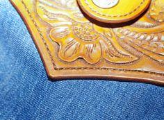 Leather and jeans handbag.  Veg tanned leather, carving, denim, linnen.