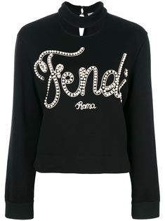 Fendi womenswear for turns wearers into little 'Karlitos' – fluorescent graphics depict a stylized Karl Lagerfeld and pearls embellish oversized cursive. The flamboyance is set against black backdrops, for nonchalant elegance that's unmistakably Fendi. Fendi Sweater, Mothers Day Shirts, Embroidered Sweatshirts, Black Knit, Nice Tops, Sweaters For Women, Women Wear, Graphic Sweatshirt, Fashion Outfits