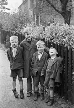 Young boys who were dug out from the rubble of their destroyed homes the morning after a Luftwaffe bombing; Coventry, England - 15 November 1940 Photo by George Rodger
