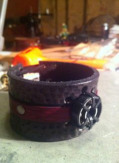 Black and Red hand tooled roller derby inspired cuff  adjustable on Etsy, $40.00