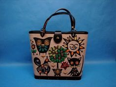 """Owl & Pussycat"" wood box bag designed by Enid Collins"