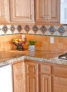 Spanish style kitchen design with saltillo tile floors for Decorative spanish tile