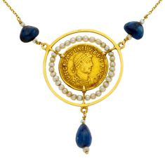 Choker with a Roman gold coin  One Roman solidus coin, Graciano, Treveri, 367-383 A.D. Subsequently mounted on a gold choker with sapphire beads and cultured pearls of 2.3 mm diam.  14 gr