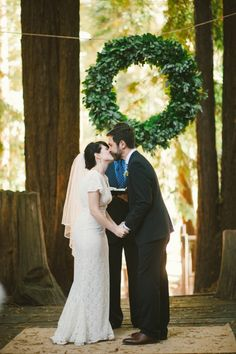Giant wreath backdrop for a Redwood forest wedding.