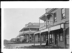 Looking down a main street in Kaponga, South Taranaki. In the foreground, on the right is the Bank of New South Wales, with the Dominion Hotel beyo. Main Street, New Zealand, Maine, Louvre, Photograph, David, Building, Board, Places