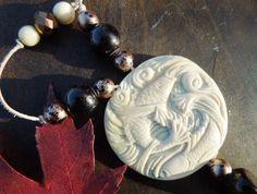 Mammoth Ivory Good Luck Pendant by RavensIvoryArt on Etsy, $145.00