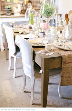 The combination of rustic wood slab table with french inspired side chairs adds to the beautiful look and scale of this table. Dinning Room Tables, Dining Decor, Dining Rooms, Wood Slab Table, Dinner Party Table, Table Setting Inspiration, Shop Interiors, Bird Cage, Side Chairs