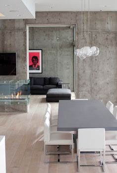 the concrete walls and the fireplace