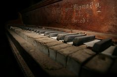 I love the mystery in this photo. I wish I could listen to this piano tell the many stories and songs of it's lifetime.