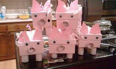 Made out of shoe boxes, paper rolls, hot glue and more paper!!! Put gifts in them for a SURPRISE PIG PARTY!