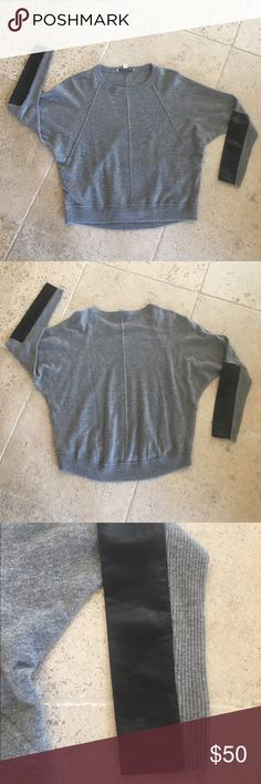 Cashmere/sheep skin sweater Stunning cashmere with sheep skin trim on the arms. Only worn once!  Superb condition! Autumn Cashmere Sweaters