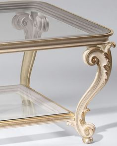 coffee tables with glass top. Louis XV style carved wood table with scroll and leaf motif, antique ivory finish and antique silver leaf trim; This Louis XV table is hand-made in Italy