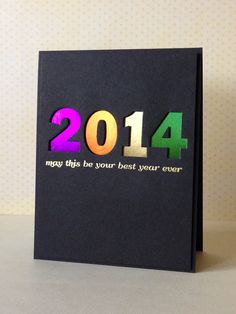 create the year with your numbers die set on black cardstock and back it with shiny happy new year cardscasual