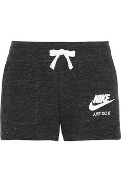 Cut from soft cotton-blend jersey for comfort and freedom of movement, Nike's charcoal 'Vintage' shorts will make a versatile addition to your gym kit. They have an elasticated drawstring waist and slant pockets. Wear yours solo or slip them on over leggings for added coverage and insulation. #Nike