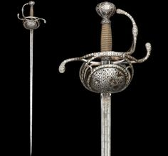 Field officer sword, German, circa 1630. Sword designers conjured up a magic combination- a rapier style guard with a blade somewhere between a rapier and cutting sword. The sword rapier became the sword of choice for most of the military. It was carried by many combatants in the Thirty Years War (1618-1648 AD).