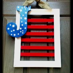 July 4th Front Door Wreath! DIY! Old wood frame, red ribbon, hobby store letter: star stickers, paint blue, remove stickers! Burlap tie hides metal picture wire!