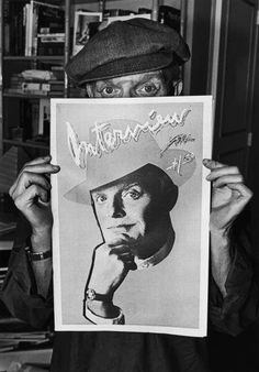 Truman Capote, playfully poses during a portrait session behind a copy of Interview Magazine featuring his likeness, New York, 1980.  (Photo: by George Rose/Getty Images)