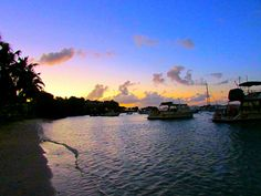 Cruz Bay Beach never disappoints for a colorful sunset. www.cateredto.com